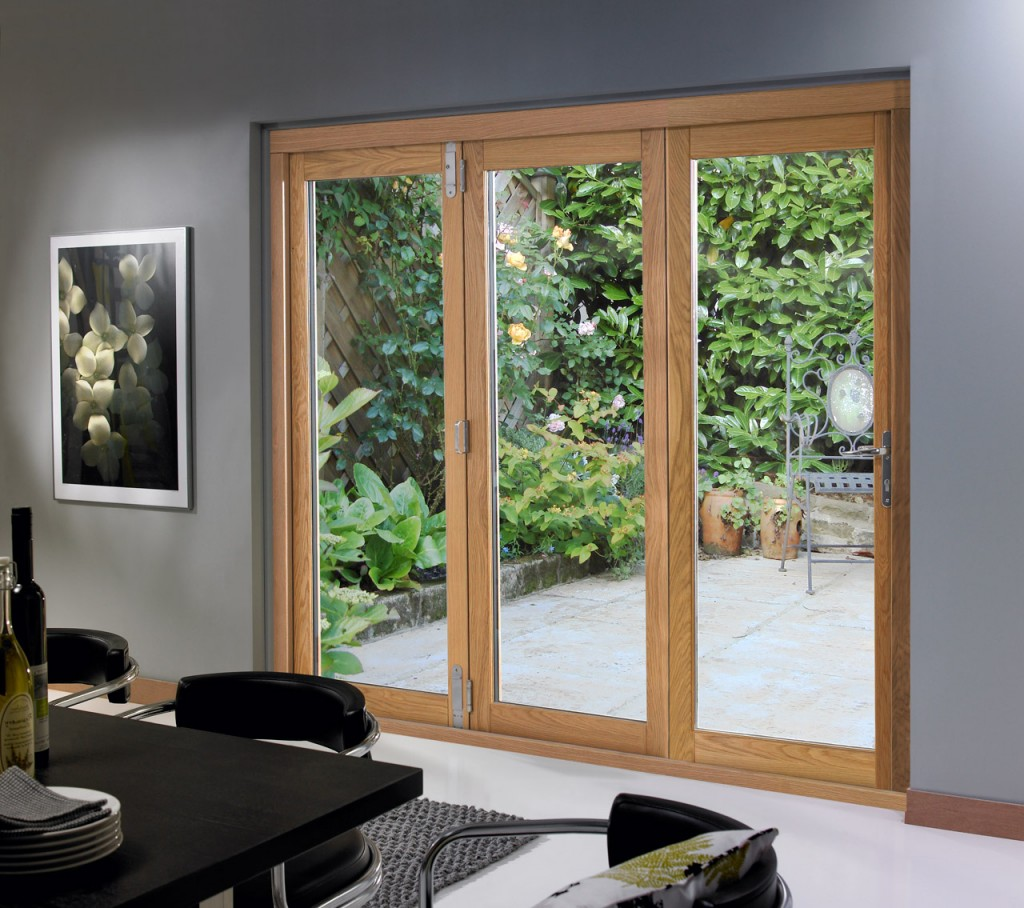 Sliding patio doors adding beauty to your home garden for Three panel sliding glass door