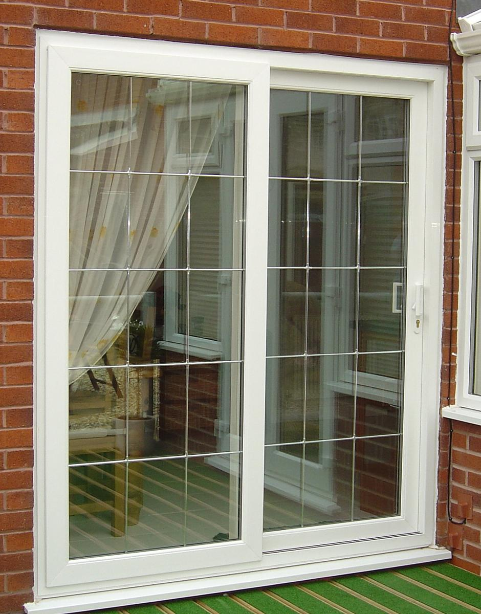 Sliding patio doors adding beauty to your home garden for Outdoor sliding doors